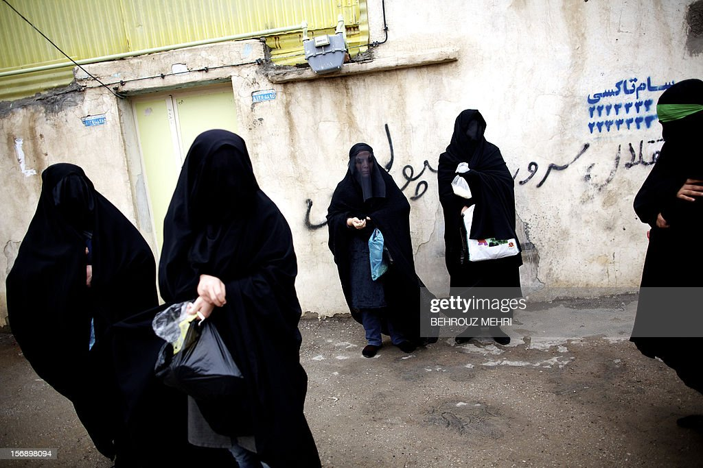 Iranian women stand in the street as they light candles during the 'Chehel Manbar' (Forty Pulpits) ritual a day before Ashura, in the city of Khorramabad, 470 kilometres southwest of Tehran on November 24, 2012. Traditionally, Iranian women of Khorramabad walk barefoot to light candles in 40 designated places in the city centre on the eve of the Ashura, which marks the seventh century slaying of the grandson of Prophet Mohammed, Imam Hussein.
