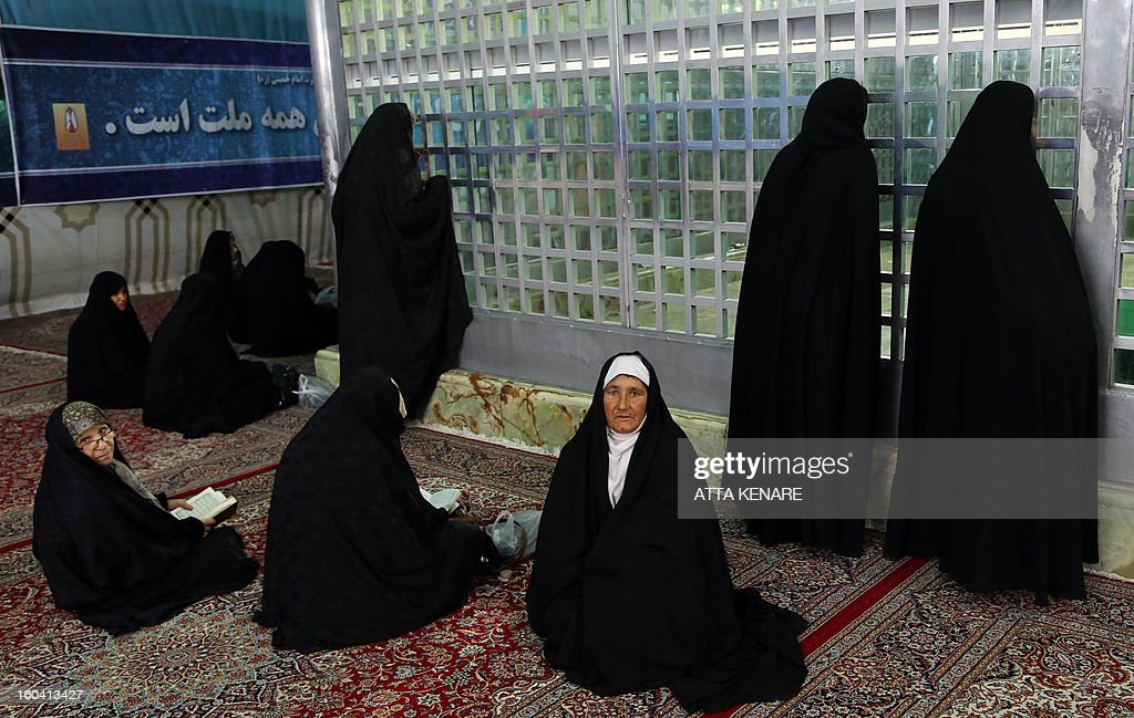 Iranian women visit the shrine of the founder of Iran's Islamic Republic, Ayatollah Ruhollah Khomeini during the 34th anniversary of his return from exile on January 31, 2013 at Khomeini's mausoleum in Tehran. Bells chimed across Iran to mark his return from exile in 1979, the trigger for a revolution which spawned an Islamic state now engulfed in a deep political crisis.