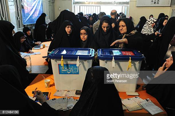 Iranian women vote in key elections for Parliament and the Assembly of Experts in the the conservative Narmak district of eastern Tehran Iran on...