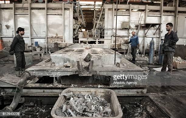Iranian workers work at Alumroll Novin Aluminum Factory in Arak Iran on October 6 2016 Alumroll Novin Aluminum Factory employs 750 workers and...