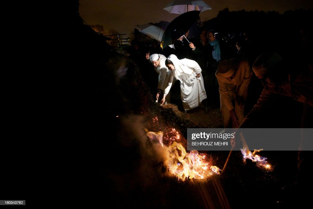 Iranian Zoroastrian priests set firewood ablaze in celebration of the annual Zoroastrian Sadeh festival in a western suburb of Tehran on January 29, 2013. Sadeh, is an ancient Persian festival that is celebrated by setting a huge bonfire to honour fire and to defeat the forces of darkness, frost, and cold. Sadeh means 'hundred' and refers to one hundred days and nights past the end of summer.