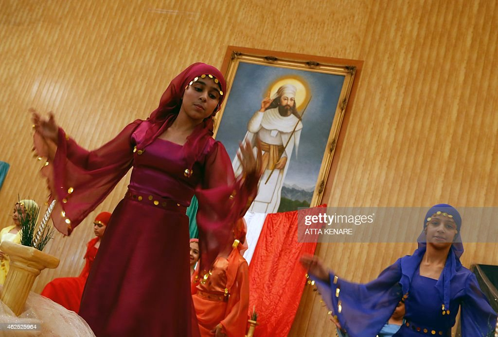 Iranian Zoroastrians perform a traditional dance in front of a painting of Iranian Prophet <a gi-track='captionPersonalityLinkClicked' href=/galleries/search?phrase=Zarathustra&family=editorial&specificpeople=980587 ng-click='$event.stopPropagation()'>Zarathustra</a> during the annual Zoroastrian Sadeh festival on January 30, 2015 Eeast of Tehran. Sadeh, is an ancient Persian festival that is celebrated by setting a huge bonfire to honour fire and to defeat the forces of darkness, frost, and cold. Sadeh means 'hundred' and refers to one hundred days and nights past the end of summer. KENARE