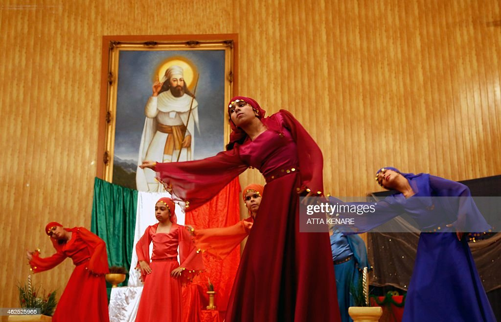 Iranian Zoroastrians perform a traditional dance in front of a painting of Iranian Prophet <a gi-track='captionPersonalityLinkClicked' href=/galleries/search?phrase=Zarathustra&family=editorial&specificpeople=980587 ng-click='$event.stopPropagation()'>Zarathustra</a> during the annual Zoroastrian Sadeh festival on January 30, 2015 Eeast of Tehran. Sadeh, is an ancient Persian festival that is celebrated by setting a huge bonfire to honour fire and to defeat the forces of darkness, frost, and cold. Sadeh means 'hundred' and refers to one hundred days and nights past the end of summer.