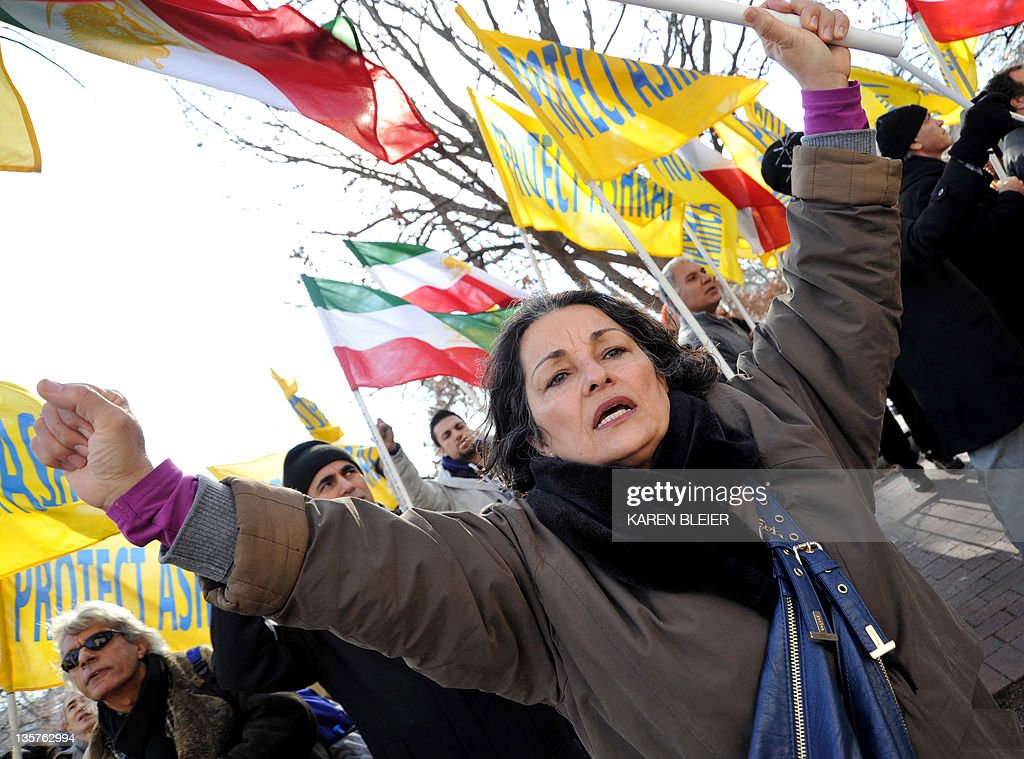 Iranian-Americans wave banners and shout slogans against Iraqi Iraqi Prime Minister, Nouri-al-Maliki December 13, 2011 near the US Chamber of Commerce in Washington, DC. Simultaneous with the visit of Maliki, to the Chamber of Commerce, Iranian-Americans and relatives of the 3400 Iranian dissidents at Camp Ashraf held a rally against Maliki and his plans to, at behest of the Iranian regime, close Camp Ashraf and forcibly relocate its residents by the end of the year. The family members of Ashraf residents and Iranian-Americans believe this would prelude a massacre of defenseless residents of the camp. Iraqi Armed Forces, under the command of Maliki, violently attacked Camp Ashraf twice -- in July 2009 and in April 2011 -- killing 47 and wounding more than 1,000 unarmed residents. Iranian-Americans believe Maliki should be held accountable for the crimes he committed against humanity. The residents of Camp Ashraf signed an agreement with the US Government in 2003, guaranteeing their protection until their final disposition. AFP PHOTO/Karen BLEIER