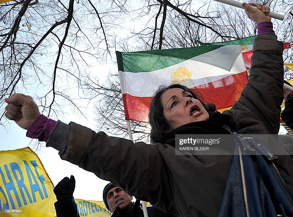 Iranian-Americans wave banners and shout slogans against Iraqi Prime Minister, Nouri-al-Maliki December 13, 2011 near the US Chamber of Commerce in Washington, DC. Simultaneous with the visit of Maliki, to the Chamber of Commerce, Iranian-Americans and relatives of the 3400 Iranian dissidents at Camp Ashraf held a rally against Maliki and his plans to, at behest of the Iranian regime, close Camp Ashraf and forcibly relocate its residents by the end of the year. The family members of Ashraf residents and Iranian-Americans believe this would prelude a massacre of defenseless residents of the camp. Iraqi Armed Forces, under the command of Maliki, violently attacked Camp Ashraf twice -- in July 2009 and in April 2011 -- killing 47 and wounding more than 1,000 unarmed residents. Iranian-Americans believe Maliki should be held accountable for the crimes he committed against humanity. The residents of Camp Ashraf signed an agreement with the US Government in 2003, guaranteeing their protection until their final disposition. AFP PHOTO/Karen BLEIER