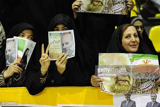 Iranians attend a rally for moderate and reformist candidates in elections for Parliament and the Assembly of Experts in an indoor sports arena on...