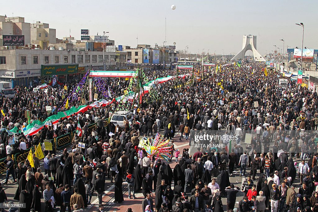 Iranians attend a rally in Tehran's Azadi Square (Freedom Square) to mark the 34th anniversary of the Islamic revolution on February 10, 2013. Hundreds of thousands of people marched in Tehran and other cities chanting 'Death to America' and 'Death to Israel' as Iran celebrated the anniversary of the ousting of the US-backed shah.