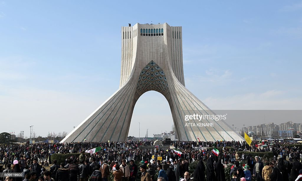 Iranians attend celebrations in Tehran's Azadi Square (Freedom Square) to mark the 37th anniversary of the Islamic revolution on February 11, 2016. Iranians waved 'Death to America' banners and took selfies with a ballistic missile as they marked 37 years since the Islamic revolution, weeks after Iran finalised a nuclear deal with world powers. KENARE