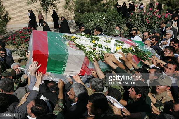Iranians carry the coffin of General NurAli Shushtari deputy commander of the Revolutionary Guards ground forces killed the day before near the...