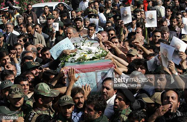 Iranians carry the coffin of General NurAli Shushtari deputy commander of the Revolutionary Guards ground forces killed two days ago near the...