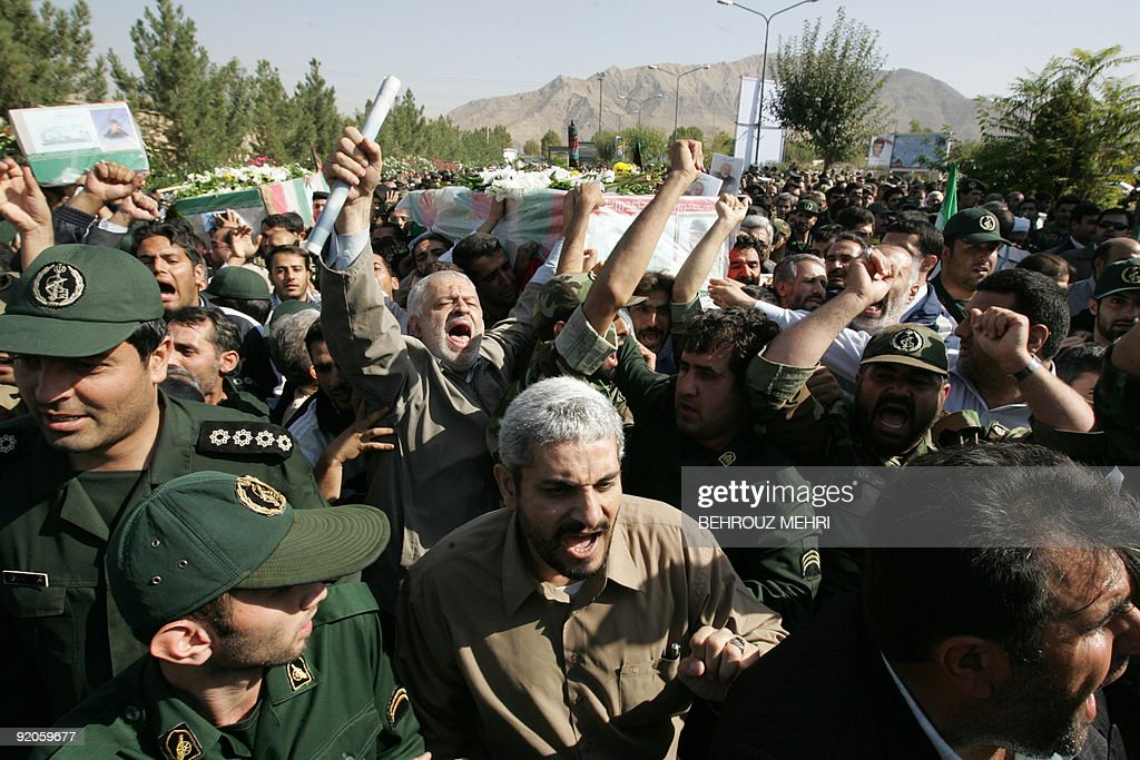 Iranians carry the coffin of General NurAli Shushtari deputy commander of the Revolutionary Guards ground forces and other members of the...