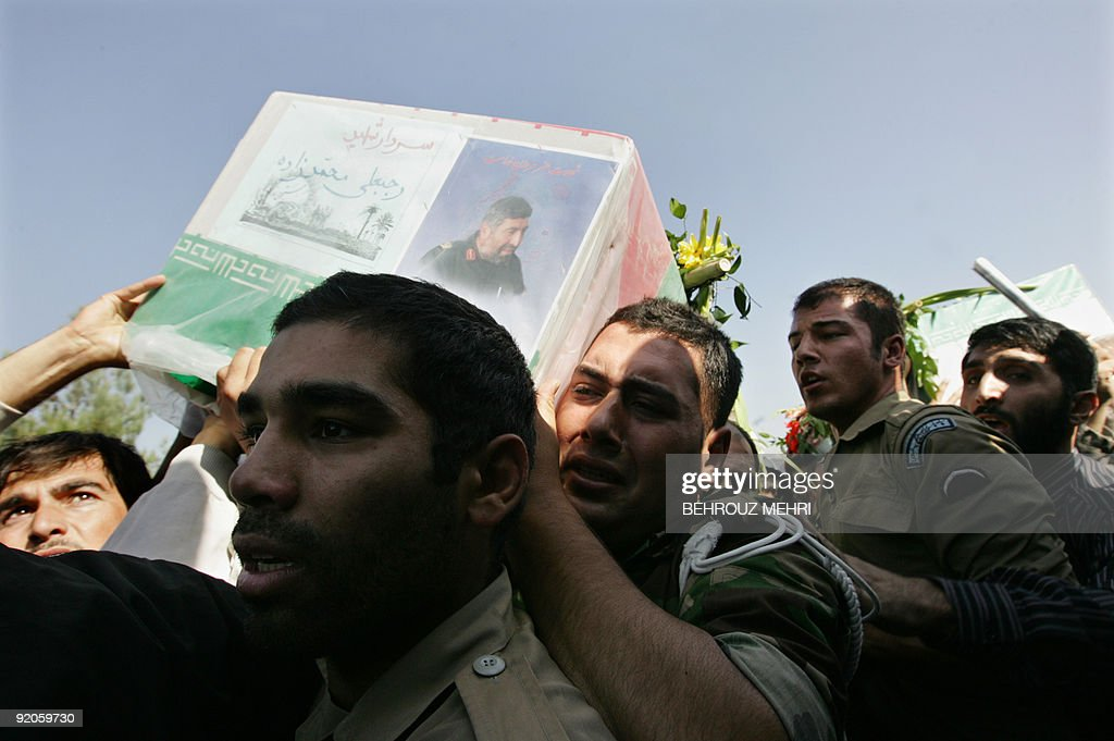Iranians carry the coffin of Rajabali Mohammadzadeh a commander of the Revolutionary Guards ground forces killed two days ago near the Pakistani...