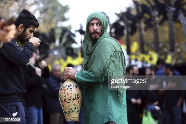Iranians celebrate the day of Ashura on November 26 2012 in Tehran Iran The day is a commemoration of the Battle of Karbala where the forces of Yazid...