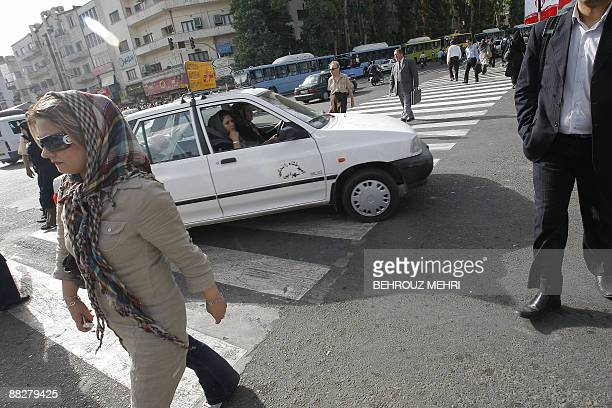 Iranians cross a street in Tehran on June 7 2009 Iran has arrested 88 people including 30 Afghans over deadly unrest that has shaken the southeastern...