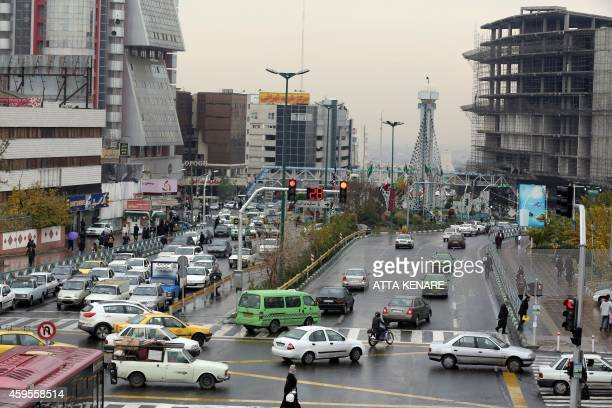 Iranians drive on a street in the capital Tehran on November 25 2014 Supreme leader Ayatollah Ali Khamenei said that Iran would not sink 'to its...