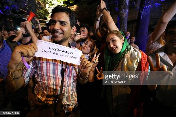 Iranians gather in celebration in northern Tehran on July 14 after Iran's nuclear negotiating team struck a deal with world powers in Vienna Iranians...