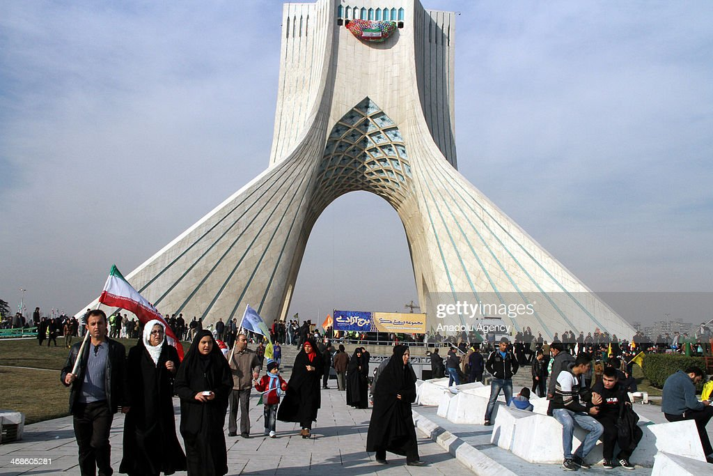 Iranians gather in Tehran's Azadi Square to stage a protest to mark the 35th anniversary of the Islamic revolution as they wave flags and banners in...
