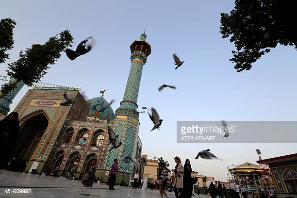Iranians gather outside Emamzadeh Saleh mosque in Tajrish square in northern Tehran on July 2 during the holy month of Ramadan Across the Muslim...