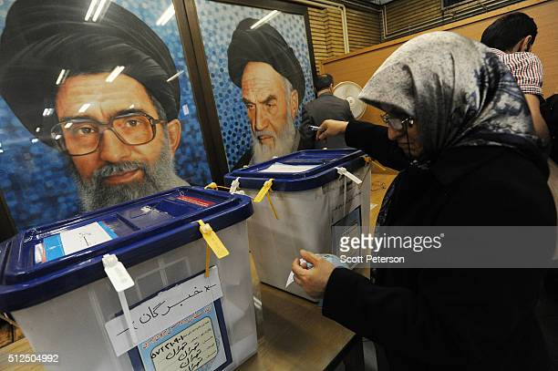 Iranians line up in long lines to vote in key elections for Parliament and the Assembly of Experts in Tehran Iran on February 26 2016 The vote is...