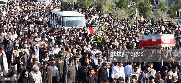 Iranians march in the funeral procession of Iran's elite Revolutionary Guards and local tribesmen in Zahedan near the Pakistani border on October 19...