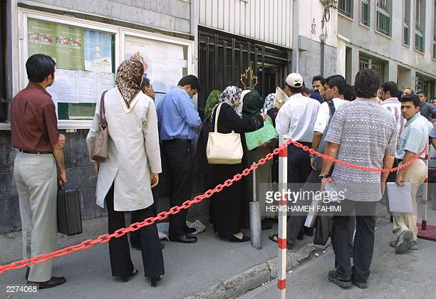 Iranians queue for immigration visas in front of the Canadian embassy in Tehran 16 June 2003 According to the various figures available on Iran's...