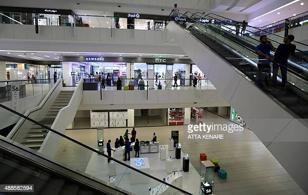 Iranians shop at a mall in the north of the capital Tehran on August 19 2015 Experts say the expected lifting of sanctions imposed over Iran's...