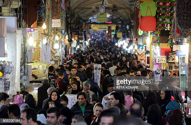 Iranians shop in Tehran's ancient Grand Bazaar on January 16 2016 Iran's Foreign Minister Mohammad Javad Zarif said nuclearrelated sanctions on his...
