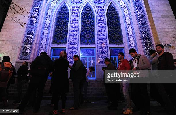 Iranians stand in long lines for voting that extended to midnight in key elections for Parliament and the Assembly of Experts outside the Hosseiniyeh...