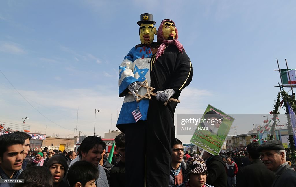Iranians surround dummies during celebrations in Tehran's Azadi Square (Freedom Square) to mark the 37th anniversary of the Islamic revolution on February 11, 2016. Iranians waved 'Death to America' banners and took selfies with a ballistic missile as they marked 37 years since the Islamic revolution, weeks after Iran finalised a nuclear deal with world powers. KENARE