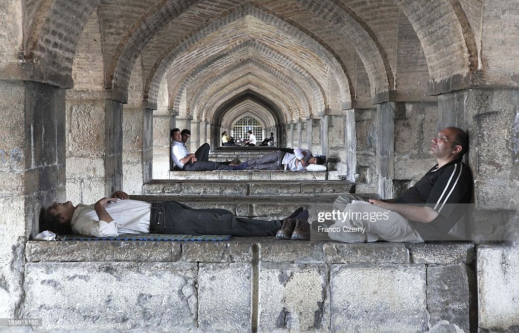 Iranian's take a nap and cool off at the Khaju bridge on August 17, 2012 in Isfahan, Iran.