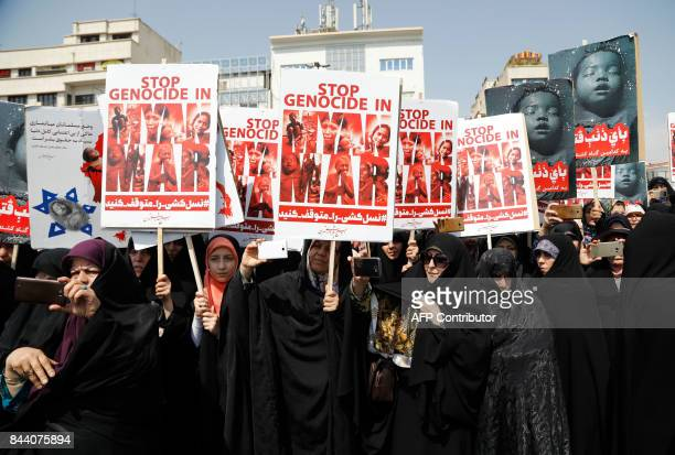TOPSHOT Iranians take part in a protest against violence in Myanmar after weekly Friday prayer in Tehran on September 08 2017 Iran's foreign minister...