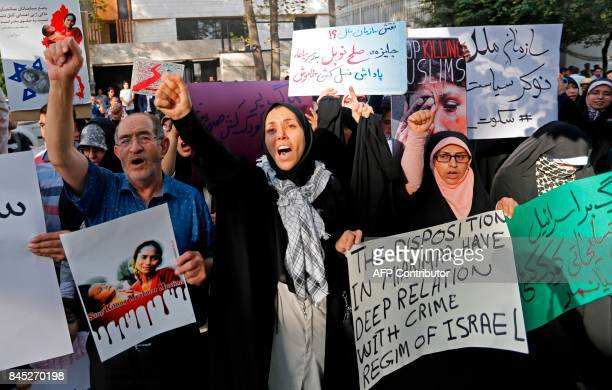 Iranians take part in a protest against violence in Myanmar in front of the United Nations office in Tehran on September 10 2017 Iran's foreign...