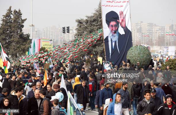 Iranians take part in a rally marking the anniversary of the 1979 Islamic revolution on February 10 in the capital Tehran Millions of Iranians...