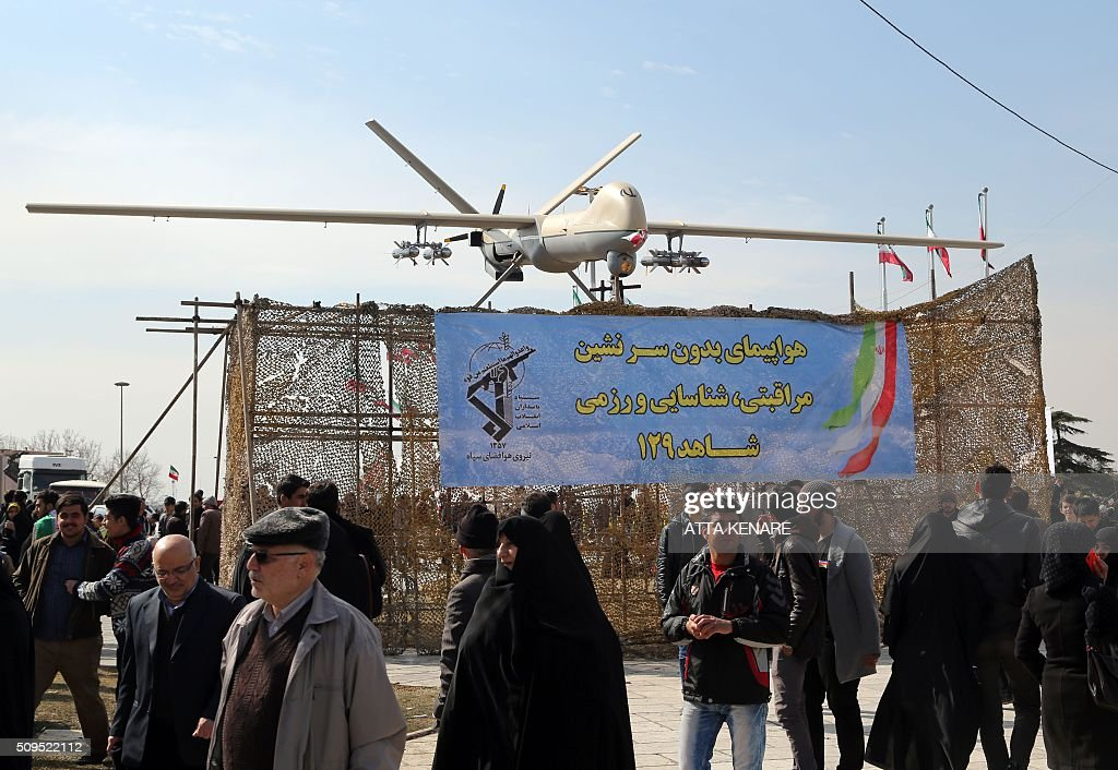 Iranians walk past Iran's Shahed 129 drone displayed during celebrations in Tehran to mark the 37th anniversary of the Islamic revolution on February 11, 2016. Iranians waved 'Death to America' banners and took selfies with a ballistic missile as they marked 37 years since the Islamic revolution, weeks after Iran finalised a nuclear deal with world powers. KENARE