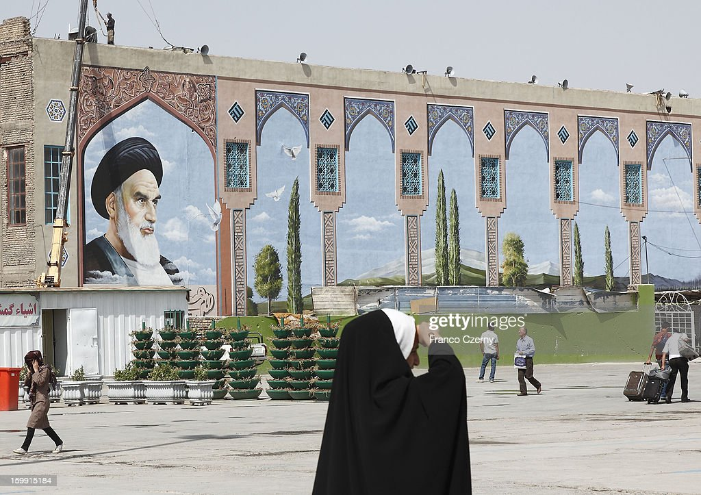 Iranian's walk past the Holy Shrine mausoleum of <a gi-track='captionPersonalityLinkClicked' href=/galleries/search?phrase=Ayatollah+Khomeini&family=editorial&specificpeople=226737 ng-click='$event.stopPropagation()'>Ayatollah Khomeini</a> on August 14, 2012 in Tehran, Iran.