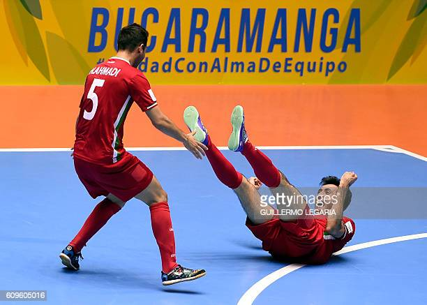 TOPSHOT Iran's Ahmad Esmaeilpour and Hamid Ahmadi celebrate their victory over Brazil in their Colombia 2016 FIFA Futsal World Cup match in...