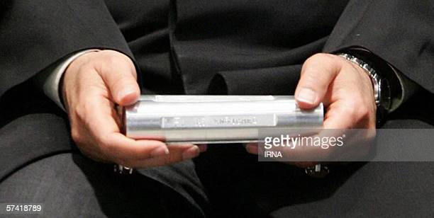 Iran's Astan Qods Razavi museum chief carries a sample of enriched uranium after President Mahmoud Ahmadinejad spoke in the holy city of Mashhad 950...