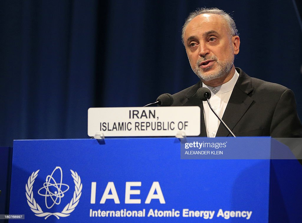 Iran's Atomic Energy Organization president <a gi-track='captionPersonalityLinkClicked' href=/galleries/search?phrase=Ali+Akbar+Salehi&family=editorial&specificpeople=3125551 ng-click='$event.stopPropagation()'>Ali Akbar Salehi</a> and Vice-President of Iran, delivers a speech during the 57th General Conference at the UN atomic agency headquarters in Vienna on September 16, 2013. The UN atomic agency said Monday it will sign an agreement with Myanmar aimed at clearing up lingering suspicions that its military junta might have sought nuclear weapons.