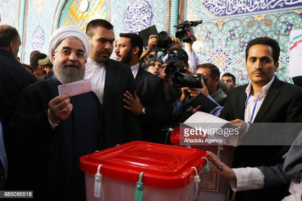 Iran's current President and presidential candidate Hassan Rouhani casts his ballot at Husayniyyahyi Irshad polling station during Iran's 12th...