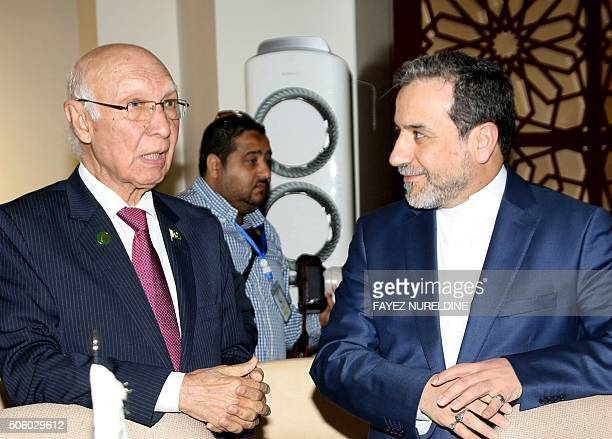 Iran's Deputy Foreign Minister Abbas Araghchi speaks with the Advisor to Pakistani Prime Minister on Foreign Affairs Sartaj Aziz during an emergency...