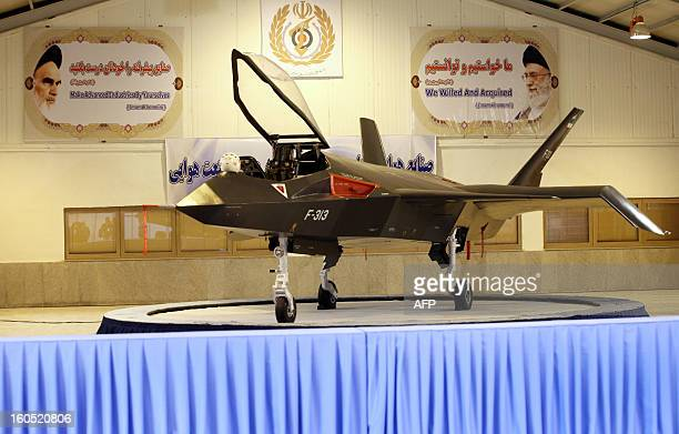 Iran's domestically designed and built Qaher F313 fighter jet is unveiled during a ceremony in a warehouse in Tehran on February 2 2013 Iran unveiled...