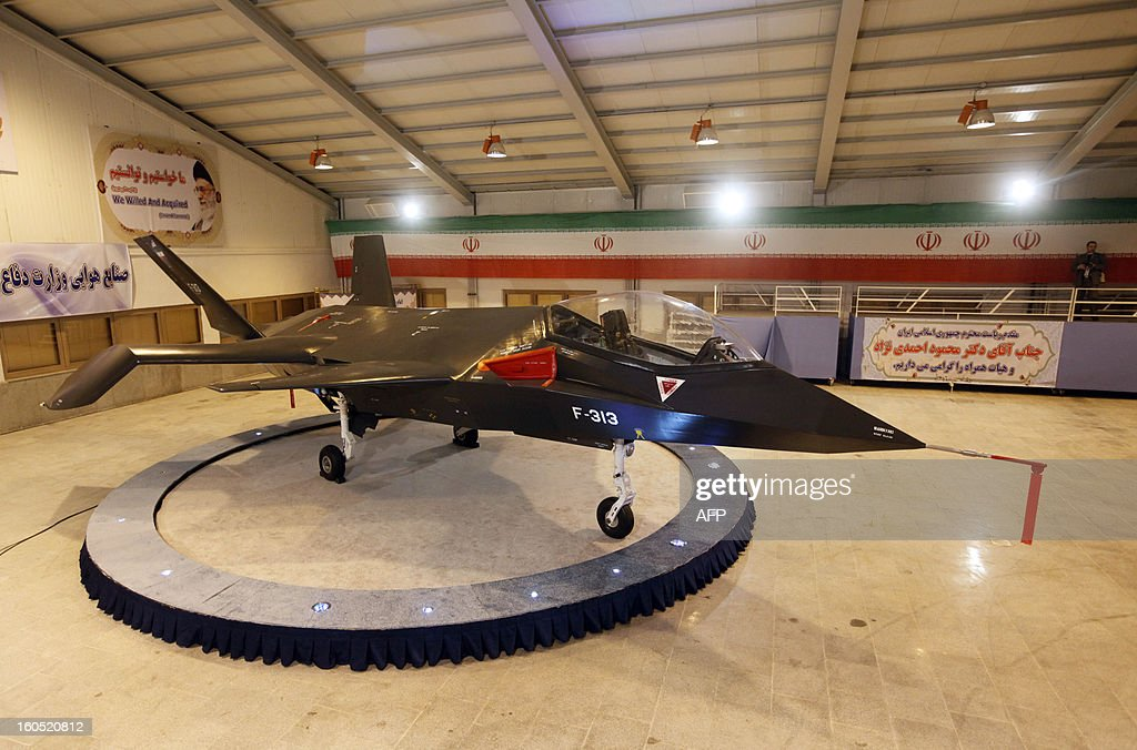 Iran's domestically designed and built Qaher (Conqueror) F-313 fighter jet is unveiled during a ceremony in a warehouse in Tehran on February 2, 2013. Iran unveiled the grey, futuristic-looking fighter jet, with President Mahmoud Ahmadinejad touting it as 'one of the most advanced' aircraft in the world.