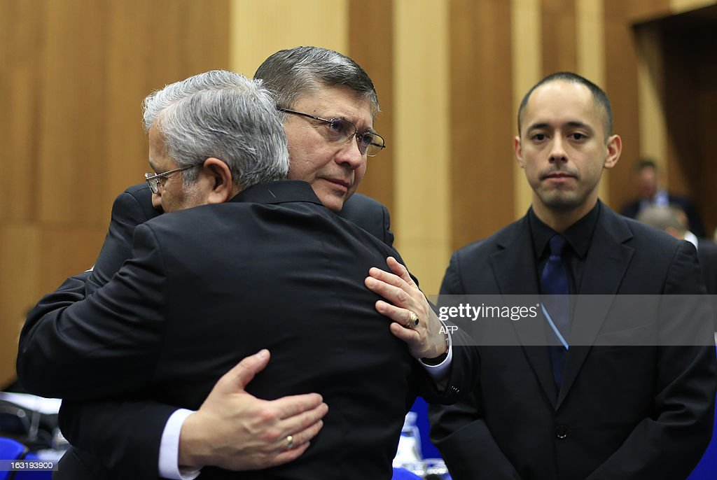 Iran's envoy to the International Atomic Energy Agency (IAEA) Ali Asghar Soltanieh (L) shows sympathy following the death of Venezuela's leader Hugo Chavez, as he greets Venezuela's Ambassador to the International Atomic Energy Agency (IAEA) Ali De Jesus Uzcategui Duque (C) during the International Atomic Energy Agency (IAEA) Board of Governors meeting at the UN atomic agency headquarters in Vienna, on March 6, 2013. Six world powers holding talks with Iran on its nuclear programme said Tuesday March 5, 2013 at a meeting of the UN atomic agency that they were 'deeply concerned' by Tehran's recent atomic upgrades.