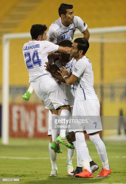 Iran's Esteghlal Khouzestan FC Aloys Nong celebrates with his teammates after scoring a goal during the AFC Champions League football match between...
