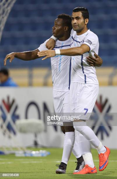 Iran's Esteghlal Khouzestan forward Aloys Nong celebrates with his teammate Hassan Beit Saeid after scoring a goal during the AFC Champions League...