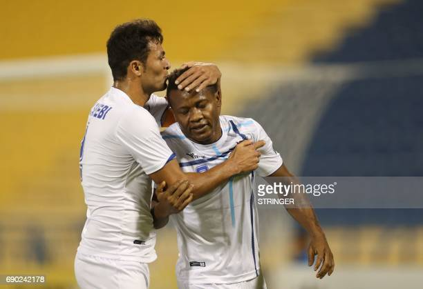 Iran's Esteghlal Khouzestan forward Aloys Nong is kissed by team captain Mohammad Tayebi after scoring a goal during the AFC Champions League...