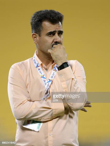 Iran's Esteghlal Khouzestan Head Coach Sirous Pourmousavi reacts on the sidelines during the AFC Champions League football match between AlHilal and...
