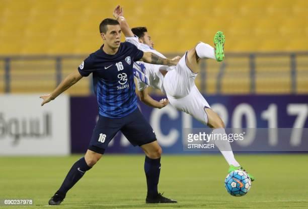 Iran's Esteghlal Khouzestan midfielder Aliasghar ashouri is tacked by Saudi Arabia's AlHilal midfielder Nicolas Milesi during the AFC Champions...