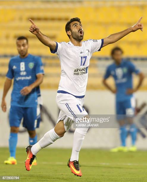 Iran's Esteghlal Khuzestan midfielder Salman Bahraini celebrates after scoring a goal during the AFC Champions League football match between Saudi...