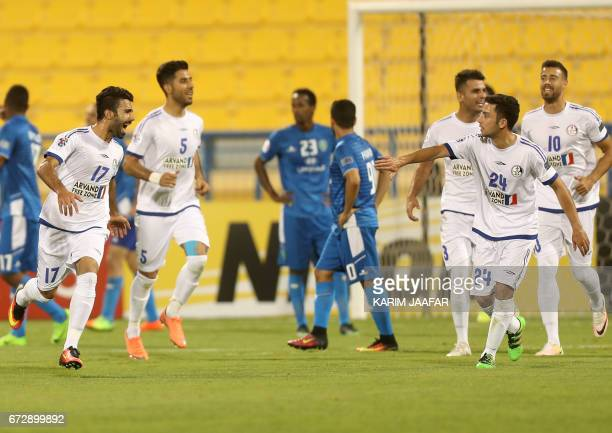 Iran's Esteghlal Khuzestan midfielder Salman Bahraini celebrates with his teammates after scoring a goal during the AFC Champions League football...